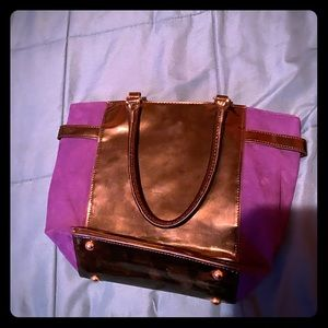 Mid size purple and black purse.